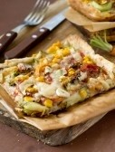 6793884-a-healthy-vegetarian-pizza-with-mushrooms-tomatoes-sweet-corn-and-zucchini