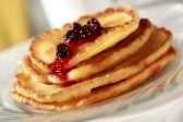 6685818-pile-of-pancakes-on-glass-plate-with-fruit-sauce-focus-on-first-part-of-sauce